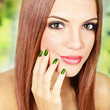 Gorgeous redhead with metalic green manicure