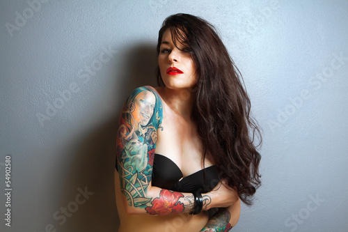 beautiful sexy tattooed woman with stylish make-up,
