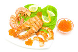 grilled salmon steak, shrimp and red caviar isolated on white ba