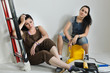 Exhausted women taking a break from renovating