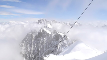 Alpine climber going down Midi Plan ridge Chamonix