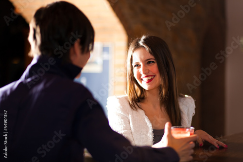 Two people having a drink in a pub