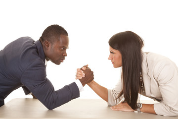 business man and woman arm wrestle serious