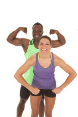 fitness man and woman flex him behind