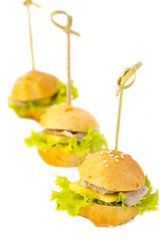 canape with meat seafood and vegetables on a white background