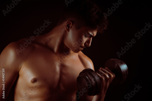 Musculed model posing in studio