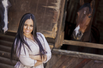 Young woman in the stable