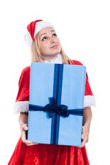 Thankful Christmas woman holding big present