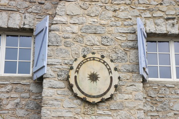 Sundial between windows