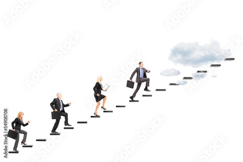 Group of businesspeople walking towards the heights