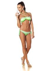 pretty and beautiful young brunette posing in a bikini