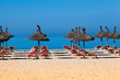 beach scenery with parasol and deck chairs. umbrella and deck ch