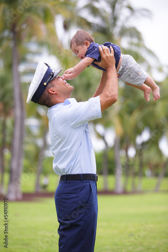 Stock image of a military dad and his son