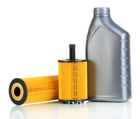 Car oil filters and motor oil can isolated on white