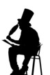 silhouette man sitting on a stool while writing