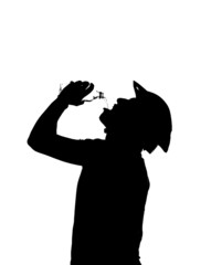 silhouette of a man drinks water to quench thirst