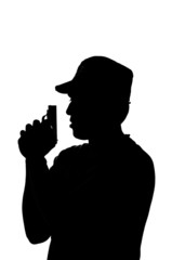 silhouette of a young male holding a gun.