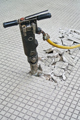 Pneumatic drill at work