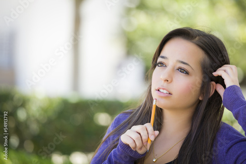 Pensive Mixed Race Female Student with Pencil on Campus