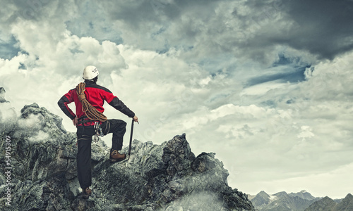 Young tourist atop of mountain