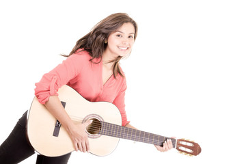 beautiful smiling hispanic lady playing acoustic guitar