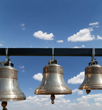 Orthodox bells closeup against the sky with clouds.
