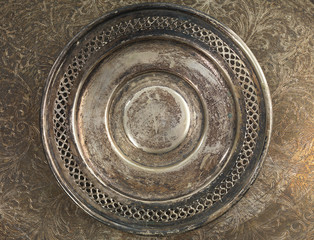 Round silver plate grungy background