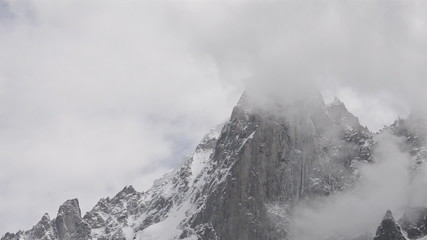 The Petit Dru west face covered in clouds and snow time lapse