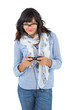 Young woman wearing scarf and glasses playing video games