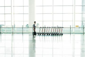 Futuristic Airport interior people walking in motion blur