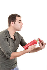 Man holding a fire extinguisher, isolated on white