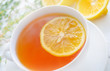 Fresh tea with lemon in the white cup