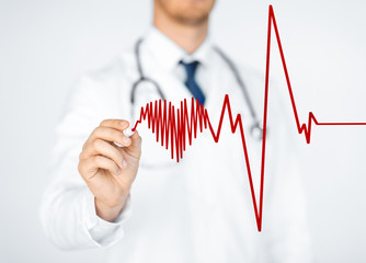 doctor drawing electrocardiogram on virtual screen