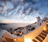 Windmill in Santorini against sunset, Greece