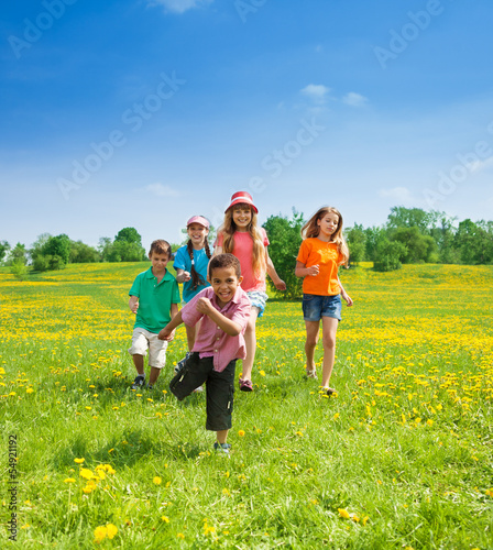 Little boys and girls running