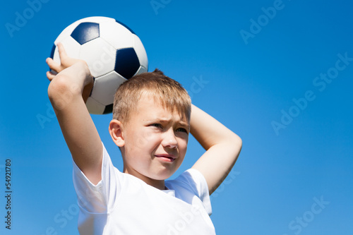 boy throws a ball for football.