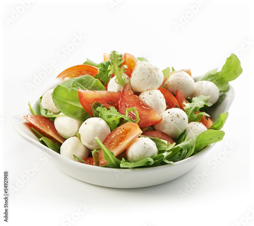 healthy fresh rucola salad with mozarella and tomato slices