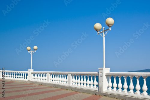 Lantern and balustrade on sea shore