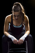 female MMA fighter sitting
