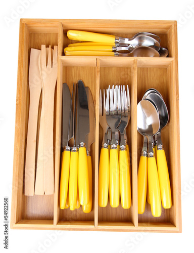 Wooden cutlery box with checked cutlery isolated on white