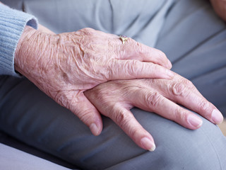 hand of senior woman holding hand of senior man