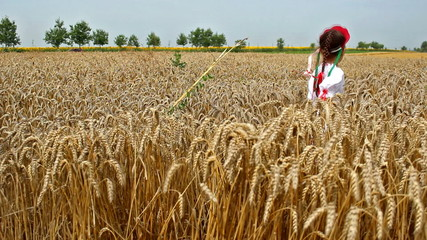 Girl in field of wheat