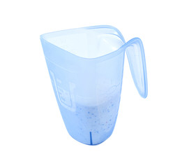 washing powder in a measuring cup