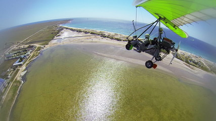 Aerial view of seashore from hang glider
