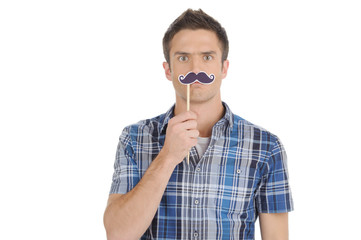 Man with fake moustache. Handsome young man with fake moustache