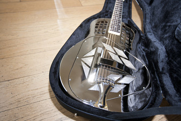Close-up view of resonator guitar in carry case