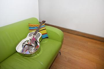 Resonator Guitar on a Green Sofa