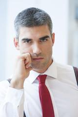 Close-up of Businessman looking seriously at camera