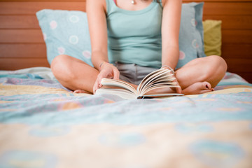 beautiful woman reading in bed