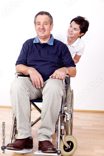 Woman pushing wheelchair